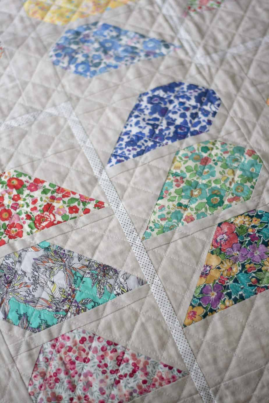 Close up of quilt featuring Liberty prints.